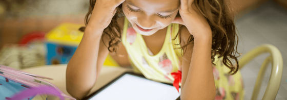 A student learning on a tablet.
